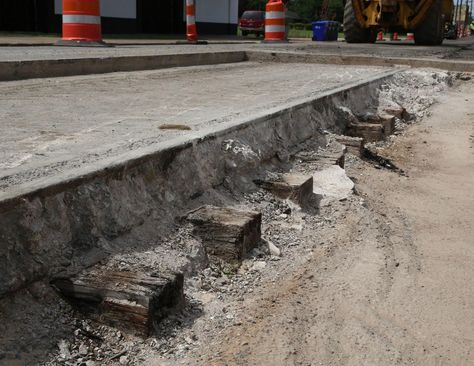 Crews Uncover Train Track Cross Ties Encased In Concrete During Elm Ave Makeover Train Tracks Train Brick Paving
