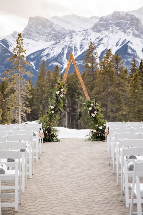 This triangle arch was designed with fresh flowers for an outdoor winter wedding in Canmore, Alberta at Silvertip Resort. Winter Mountain Wedding, Winter Wedding Ceremonies, Outdoor Winter Wedding, Winter Wedding Flowers, Outdoor Wedding Venues, Summer Wedding, Dream Wedding, Wedding Venues In Colorado, Winter Wedding Venue