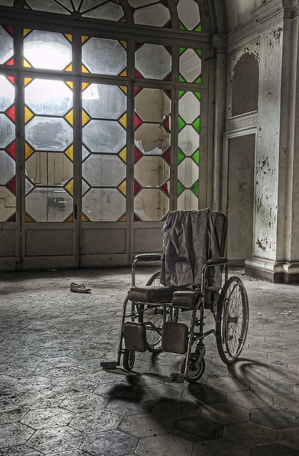 Wheel chair in abandoned asylum italy, via Flickr.