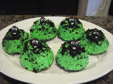 Mole Day mini bundt cakes, sprinkled with cookie crumbs. Eyes and tuft of fur added to a chocolate-covered almond.