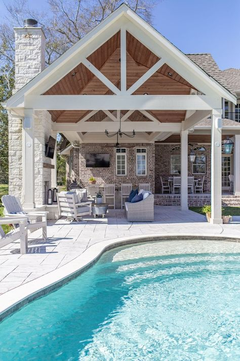 Moore House Interiors of Tomball, Texas perfectly tied together farmhouse style elements for the outdoor patio of this Houston-area home by mixing wood, brick and limestone together. Poolside Lounge, Pool House Designs, Outdoor Rooms, Swimming Pools, Dream Backyard, Pool Houses