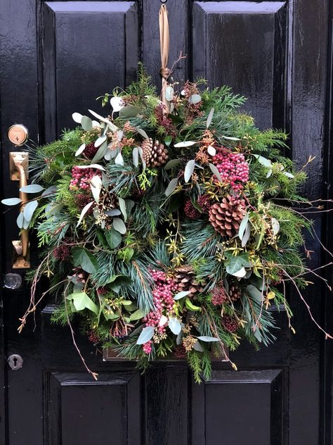 love this rustic christmas wreath with fir, pine cones, eucalyptus, poink peppercorns and twigs by The Real Flower Company. click through for inspiring DIY Christmas wreath ideas you'll love to try