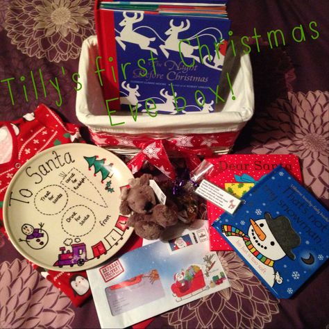 Tilly's Christmas Eve box 2013-including stories,personalised Santa plate,reindeer food,cuddly reindeer,new Christmas pjs and a letter from the big man himself!Something I hope to keep up/adapt with each year...