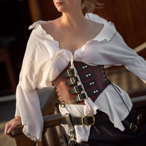 Romantic Leather Waist Cincher Pirate Corset This leather waist cincher is made of the highest quality leather and is built to last! Will work with your Pirate, Medieval, Renaissance or other cosplay costume.