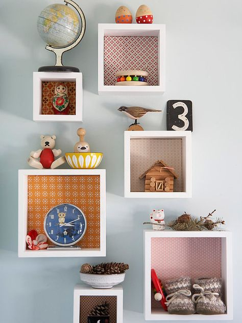 Add personal style to shadow boxes by using patterned fabric as backing. Tour the rest of this well-organized home: http://www.bhg.com/decorating/storage/organization-basics/organization-for-a-small-home/?socsrc=bhgpin081512decoratedshadowboxes#page=6