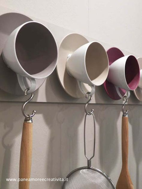 We always have coffee cups galore....fun kitchen idea... Tea Cups and S hooks