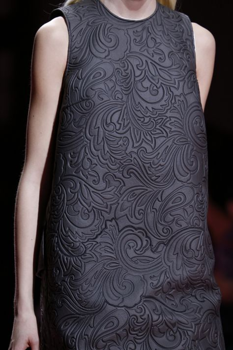 wgsn: Embossed rococo lace covers a technical fabric at the @MaryKatrantzou #AW15 collection. #LFW