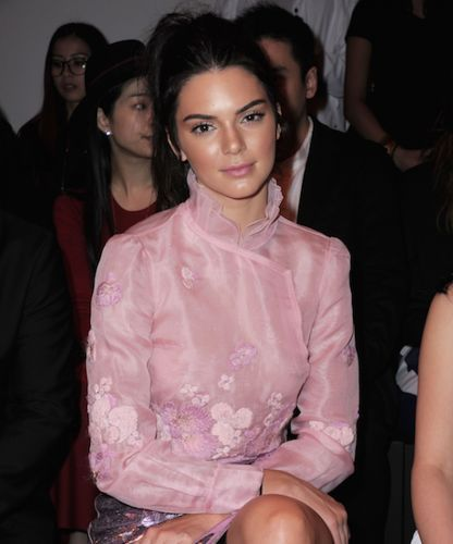 Kendall Jenner went braless in a sheer pink blouse as she headed to the Shitzy Chen fashion show in Paris for Fashion Week on Tuesday
