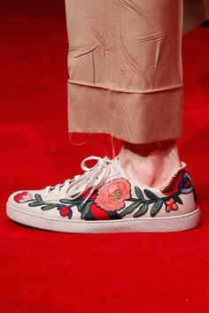 5. Embroidered Sneakers - If you're usually resistant to fashion sneakers, Gucci's intricately embroidered luxe kicks have the power to persuade. Wear with wide-leg trousers (bonus if they have an unfinished hem like this look) and you're good to go.