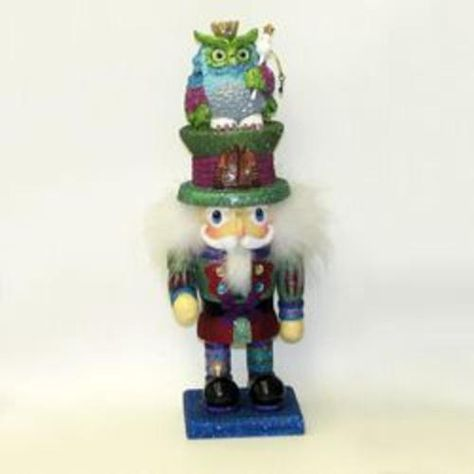 From the Hollywood Nutcracker Collection   Spiffy nutcracker holds a antique style time piece and has The Owl King perched on top of the hat he is wearing th