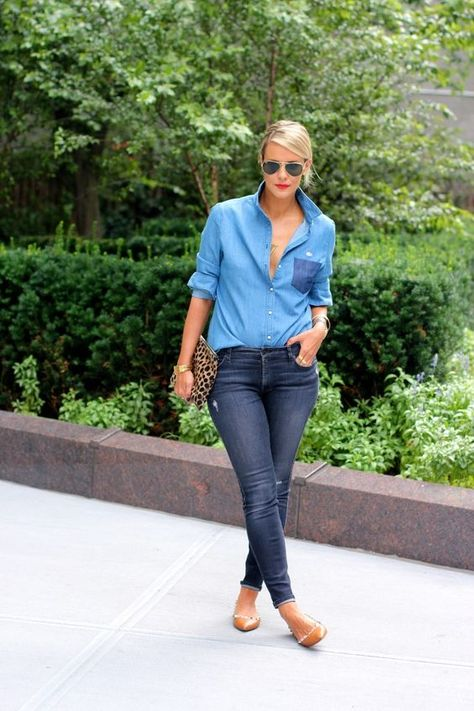 Courtney Kerr in a denim on denim outfit with a two toned chambray shirt, dark skinny jeans, and a leopard clutch