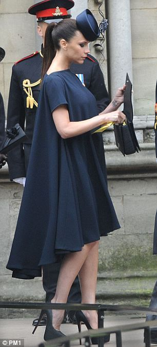 Victoria Beckham at the Royal wedding in one of her own designs from her women's wear collection - in matching fascinator