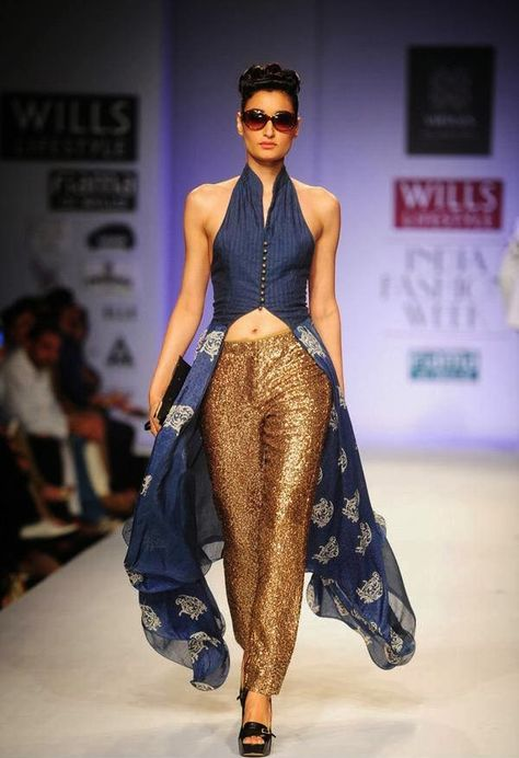 Kanishtha Dhankar showcases a creation by fashion designers Ashish Viral and Vikrant on Day 5 of Wills Lifestyle India Fashion Week (WIFW) Spring/Summer held in Delhi.