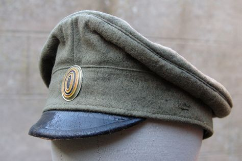 74e1994be31 Imperial Russian Army visor cap made of wool or cotton with a high crown.  The visor was made of black leather. Officers and NCOs caps had chinstraps  which ...