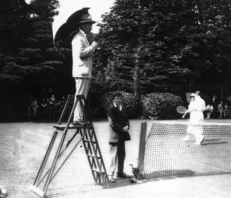 With an eagle eye - and a natty umbrella for shade - this umpire upheld the rules at an exhibition match in aid of Horsham New Hospital in 1923.