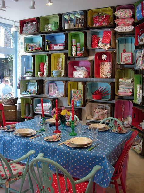 Crates, Paint, and screw on the wall! Obviously not this many crates (this is from a Cath Kidston shop) but the idea is cute!