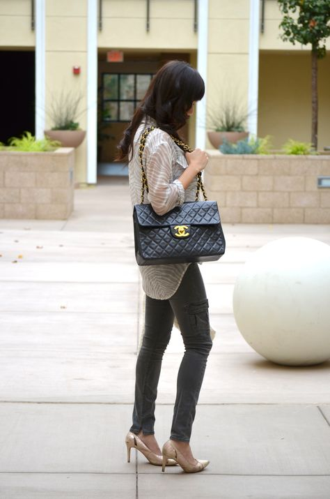 8e24465b8164ff A review of the Jumbo XL Chanel bag in black lambskin with gold hardware.