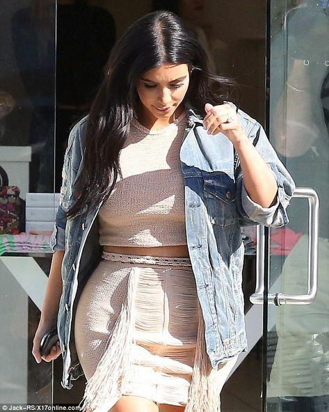 Kourtney Kardashian flashes midriff in busty barely-there