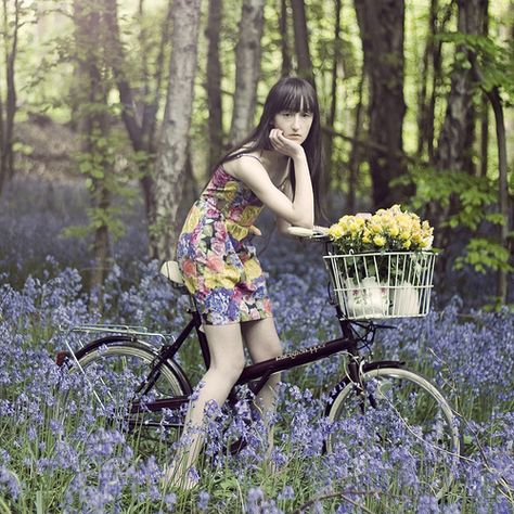 girl bicycle nature flowers