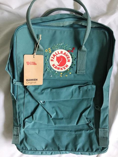 Express your style with this one of a kind, hand embroidered, authentic fjallraven kanken backpack! Purchased bag will be in color blue ridge unless otherwise requested New with tags original kanken Backpack dimensions: 15 x 10.6 x 5.1 16 liter capacity Backpack includes two side pockets and one