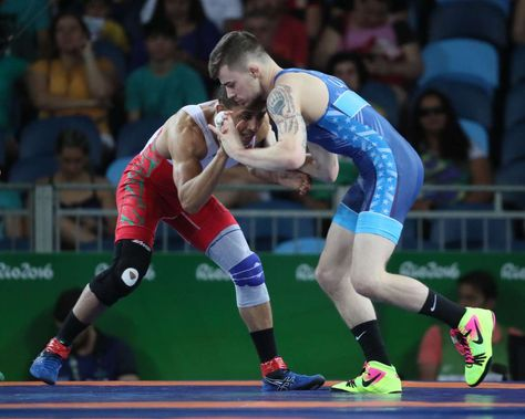 Best images from Aug. 14 at the Rio Olympics:      Jesse David Thielke of the United States competes against Mahadi Messaoudi El of Morocco during the men's greco roman 59g kg wrestling 1/8 finals in the Rio 2016 Summer Olympic Games at Carioca Arena 2.