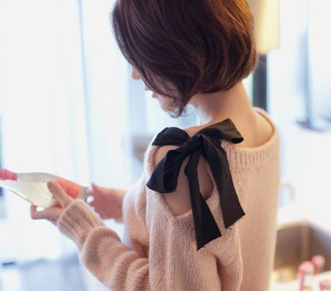 """Take an old sweater. Cut a slit in along the shoulder down about 7"""". Fold over raw edge and sew in place. Sew a piece of ribbon about 15"""" long to one side of neckline and another ribbon to the other side of the neckline. Tie together and presto! New sweater!"""
