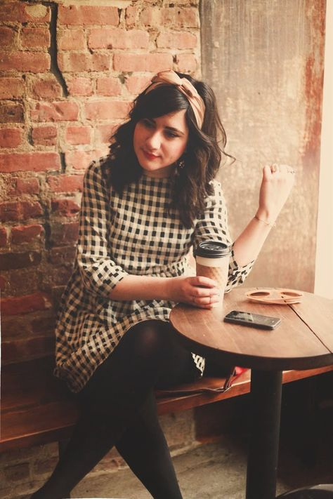 Love the patterned dress with dark tights... and the head band! Coffee Shop Fashion