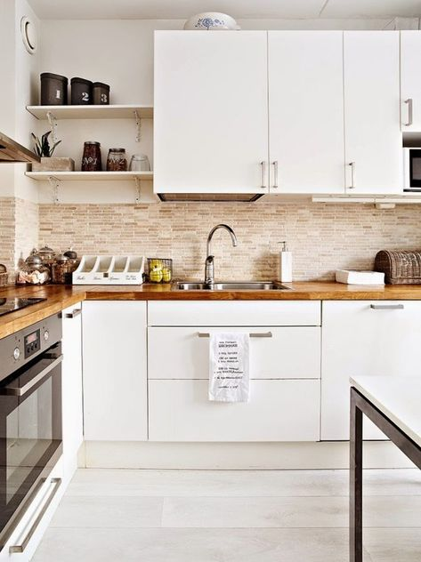 White gloss kitchen units by Ikea, Brick Slip Wall Fired Earth - ostermann trends küchen
