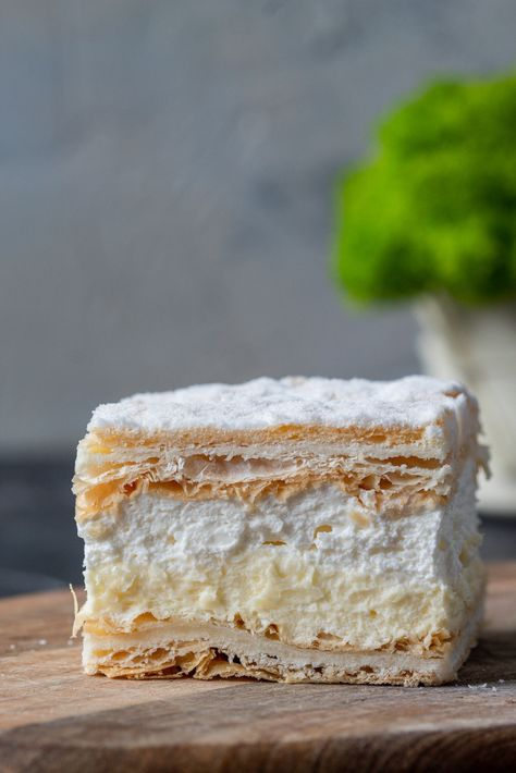 Papal cream cake or kremowka is one of the best Polish desserts ever. A smooth vanilla custard filling and whipped cream between 2 layers of French puff pastry are just delicious. Once you try them you will not be able to stop them eating. It is definitely worth to try. #kremowka #dessert #Polish #polishrecipe