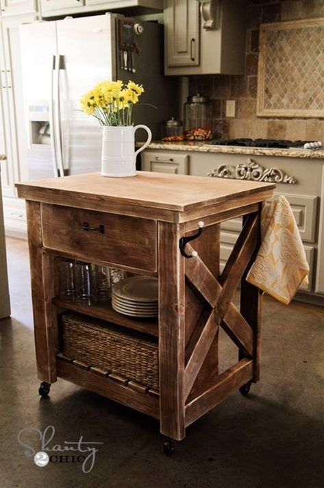 Rustic Kitchen Island. Perfect size for a small kitchen, and the towel hooks are a good idea.