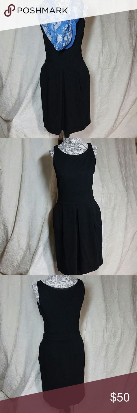 Eva Franco Little Black Dress 8 Dress is in very good condition. True to size. Very comfortable and soft. Has 2 side pockets. 71% Polyester 23% Rayon 6% Spandex Scarf not included. Eva Franco Dresses Midi