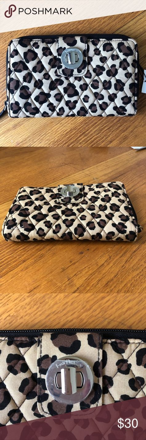 NWT Large Vera Bradley Wallet Cheetah Print New with tags! This wallet is great for someone who has a lot of cards! Also very good for some who just wants a wallet to carry around! Still has plastic cover on metal clasp. Diver for cash and coupons. Two ID holders! In mint condition! New with tags! Vera Bradley Bags Wallets