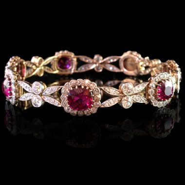 Beautiful and delicately designed bracelet with eight graduating ruby and diamond clusters in between stylised floral diamond-set motifs Edwardian, circa 1910