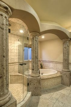 Superbe Columns And Arches Made Of Natural Stone Surround This Majestic Bathroom.