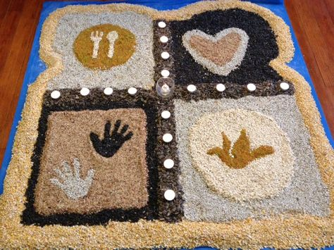 """Mandala in shape of bread made out of birdseed. During worship, people collected a bag of birdseed to take home and feed the """"world"""""""