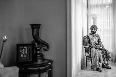 Sikh groom waits for his wedding ceremony to begin. Photograph by Catch Motion Photography, VA #blackandwhite #sikhgroom #photography #sikhgroom #indianwedding #backyardwedding #covidwedding #virginiaweddingphotography