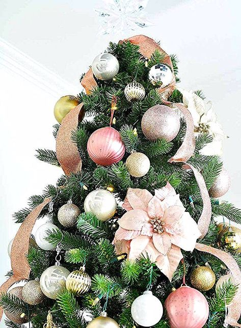 How to Put Ribbon on a Christmas Tree - Monica Wants It % #ribbononchristmastreeideas Blush and gold Christmas tree decorating ideas. #christmasdecor #christmasdecorationideas #christmascrafts #christmasdecorations #christmasdecorationsDIY #christmasdecorating #holidaydecor #holidayseason #holidaydecorations #holidaycrafts #ornaments #xmastreedecorations #christmastreedecoration #christmastreedecorideas #christmastreeornaments #christmastreeideas #ribbononchristmastreeideas How to Put Ribbon on