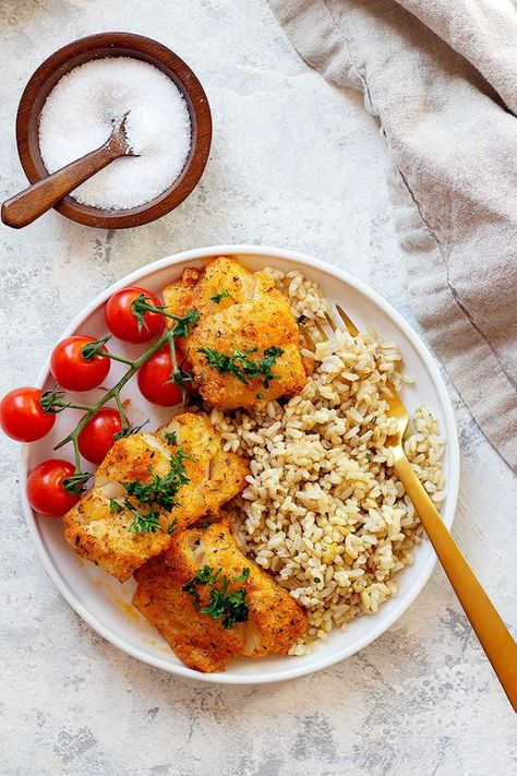 This is the best oven baked parmesan cod recipe! Tender cod fillets are coated with a delicious parmesan and spice mixture and are baked to perfection. This whole dish takes less than 30 minutes to make and is a healthy dinner with so much flavor. #codrecipe #mediterraneanfood #easydinner #seafoodrecipe #bakedcod