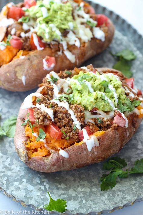 These Taco Stuffed Sweet Potatoes will take your taco night to a new and healthy level! Nutritious sweet potatoes are filled with your favorite taco toppings and ready in under 20 minutes! The perfect quick and healthy dinner!