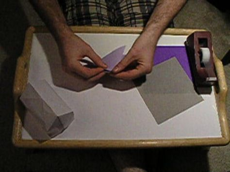 Folding a simple 3D origami house by Troy  Alexander. Here's my tutorial... I run through two iterations of folding the house, so hopefully between the two of them you'll get the views you need to replicate the process yourself.  As my email to the IRON folders said, feel free to contact me if you have questions.