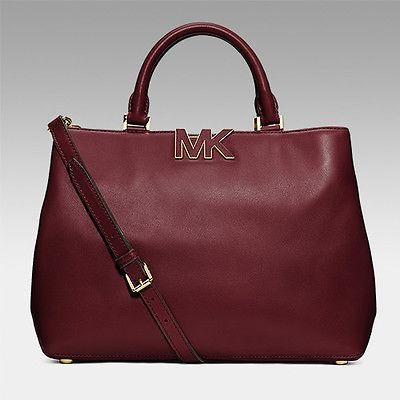 3496db78f258 A simple, streamlined silhouette highlighted by some tasteful branding  makes this Michael Kors satchel the perfect choice as your everyday  carryall.