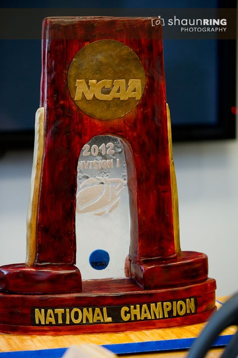 Brandi Romines, owner of Happy As A Lark Cakes, surprised Coach Cal and his staff on Monday with an edible cake that looked exactly like the national championship trophy that sits in the Joe Craft Center trophy case.