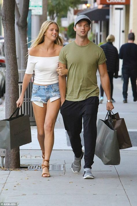 Casual cutie:For their shopping day, the model donned a pair of cut-off denim shorts with a white off the shoulder top and strappy sandals