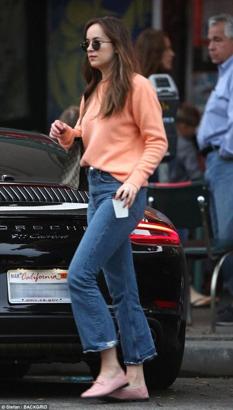Stunner: The actress turned heads on the tony Melrose Avenue as she rocked a peach sweater and denim jeans