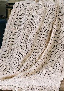 Swirling Fans Blanket is one of the prettiest lacy crochet afghans. It looks like an elegant eyelet doily! | AllFreeCrochetAfghanPatterns.com