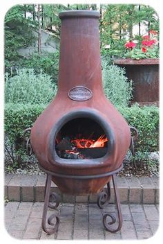 The Cast Iron Aussie Heatwave Outdoor Fireplaces Or Chimineas Are Available  In One Size, Two Styles, CLASSIC (Plain) And GRAPE Vine Design.