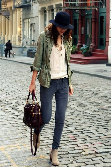 olive green jacket, white shirt, hat, grey jeans, ankle boots
