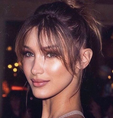 wispy bangs, fringe bangs, curtain bangs bella hadid We're taking hairstyle cues from celebs that always have the best bangs. Here are some of our favorite celebrities who embrace their wispy bangs enough to convince you to get your own. Baddie Hairstyles, Hairstyles With Bangs, Long Fringe Hairstyles, Bangs With Ponytail, Short Ponytail Hairstyles, Short Hairstyles For Men, Bangs With Medium Hair, Fine Hairstyles, Natural Hairstyles