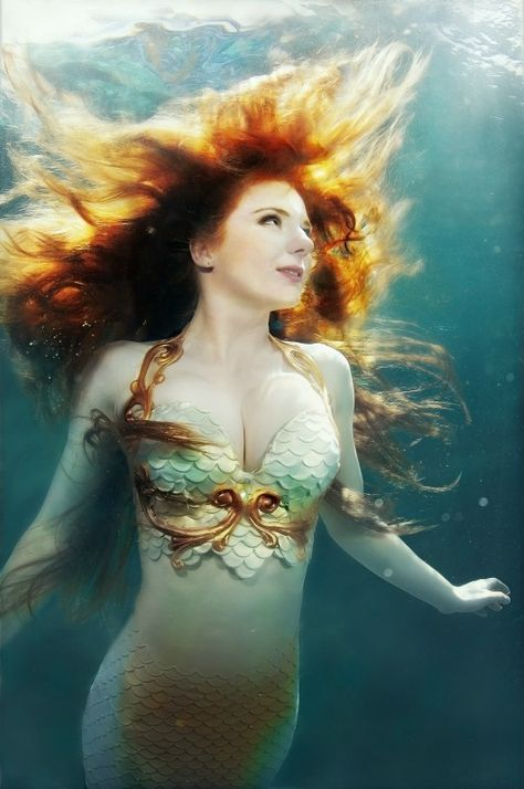 Real-life Princess Merida is an Archery Coach and Mermaid. Virginia Hankins is a warrior, actress, mermaid, stuntwoman, professional knight and much more. Her stunt work includes acting as a mermaid and a knight, and riding motorcycles. ©Brenda Stumpf