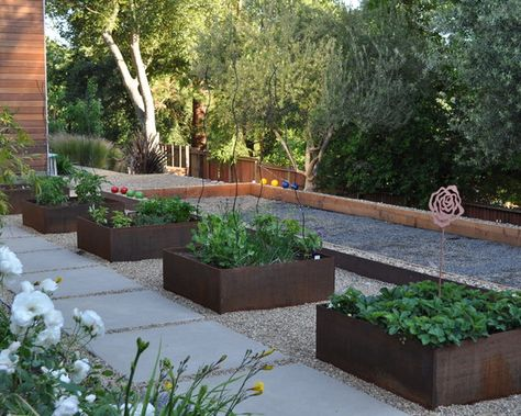This is a little modernistic for you, I think, but it shows square vegetable beds with gravel walkways, which I think looks great. Plus you could do them in wood instead.